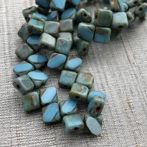 6mm Two Hole Silky Bead Medium Sky Blue with Picasso Finish